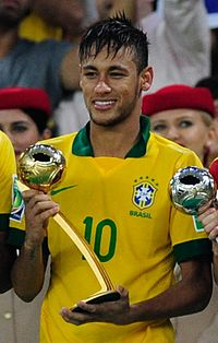 Neymar with the Golden Ball award for best player at the 2013 Confederations Cup