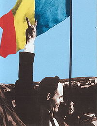 Deputy Gheorghe Ghimpu replaces the Soviet flag on the Parliament with the Romanian flag on 27 April 1990.