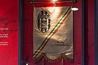 Former Juventus oval emblem (top left) featured in a pennant, at SK Slavia Prague's museum.
