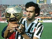 Michel Platini holding the Ballon d'Or in bianconeri (black and white) colours