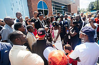 Protesters gather at the Ferguson police department