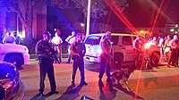 St. Louis County police protect the scene eight hours after the shooting