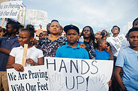 """Hands up!"" sign displayed at a Ferguson protest"
