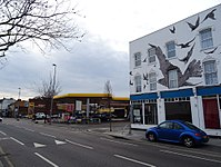 Petrol station at the site of 517 High Road, Leytonstone, where Hitchcock was born; commemorative mural at nos. 527–533 (right).