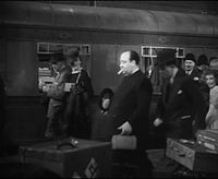 Hitchcock's cameo appearance in The Lady Vanishes (1938)