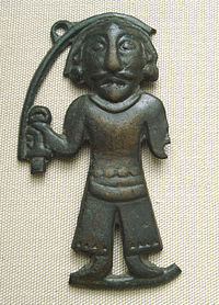 Bronze plaque of a man of the Ordos Plateau, long held by the Xiongnu. British Museum.  Otto Maenchen-Helfen notes that the statuette displays Caucasoid features.