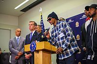 Snoop Dogg and Los Angeles Mayor Eric Garcetti speaking at a press conference following the 2016 shooting of Dallas police officers