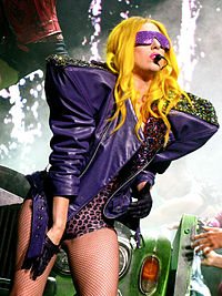 Gaga performing on The Monster Ball Tour in 2010. It grossed $227 million and became the highest-grossing concert tour for a debut headlining artist.