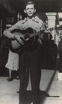 Hank Williams playing guitar in Montgomery, Alabama in 1938