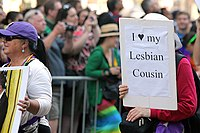 Person carries sign at 2013 pride parade saying they love their lesbian cousin