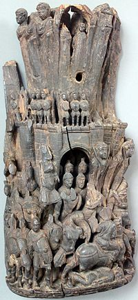 Boxwood relief depicting the liberation of a besieged city by a relief force, with those defending the walls making a sortie. Western Roman Empire, early 5th century AD