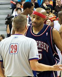 Carter talks with a referee during a game with the Nets, January 2006