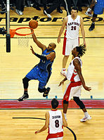 Carter with the Magic performs a layup against the Raptors, November 2009