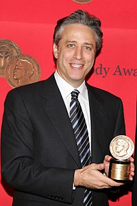 Stewart with the Peabody Award that he won with The Daily Show in 2005