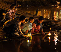 People floating krathong rafts during the Loi Krathong festival in Chiang Mai, Thailand