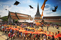 A procession during the Hae Pha Khuen That festival of Wat Phra Mahathat