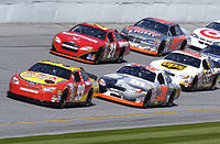 Cars practicing in 2004