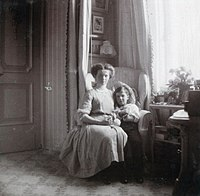 Grand Duchess Olga with her brother, Tsarevich Alexei, ca. 1910.
