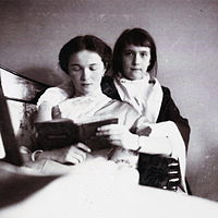 Grand Duchess Olga reads a book as her sister Grand Duchess Anastasia looks on. Courtesy: Beinecke Library