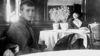 Tsarevich Alexei, left, and Grand Duchess Olga Nikolaevna in May 1918 aboard the Rus, the ship that ferried them to their deaths at Yekaterinburg. This is the last known photo of Olga and Alexei.
