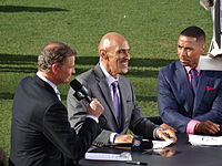 Dungy (center) along with colleagues Dan Patrick and Rodney Harrison at an NFL game in Denver in September 2013
