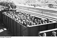 Soviet POWs transported in an open wagon train. September 1941