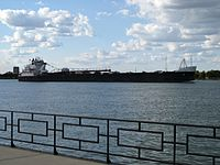 The Detroit River is one of the busiest straits in the world. Lake freighter MV American Courage passing the strait.