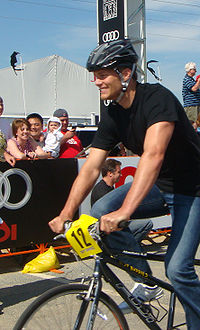 Brady riding a bicycle for charity at the Best Buddies Ride in Hyannis, Massachusetts, in May 2009