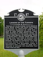 Historical marker commemorating introduction of the Macomber turnip