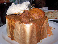 An example of bunny chow served in Durban, originated in the Indian South African community