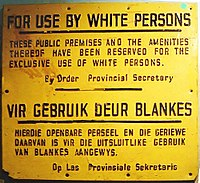 """""""For use by white persons"""" – apartheid sign in English and Afrikaans"""