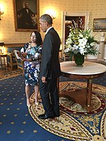 Creator Sana Amanat presenting Barack Obama a copy of Ms. Marvel Vol. 1 in the Blue Room of the White House during a reception for Women's History Month.