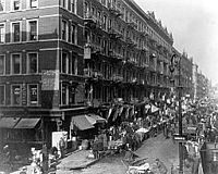 """Lower East Side in 1909. He said he never forgot his childhood years when he slept under tenement steps, ate scraps, wore secondhand clothes and sold newspapers. """"Every man should have a Lower East Side in his life,"""" said Berlin."""