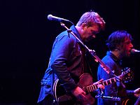 Josh Homme and Michael Shuman performing in 2011