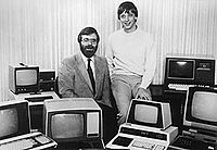 Paul Allen and Bill Gates pose for the camera on October 19, 1981, surrounded by PCs after signing a pivotal contract with IBM.