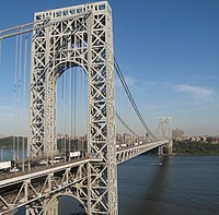 The George Washington Bridge, connecting Upper Manhattan (background) from Fort Lee, New Jersey across the Hudson River, is the world's busiest motor vehicle bridge.
