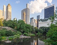 View (2019) of The Pond and Midtown Manhattan from the Gapstow Bridge in Central Park, one of the world's most visited tourist attractions