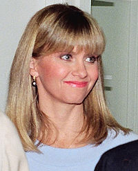 Newton-John at the opening of a Koala Blue store in 1988