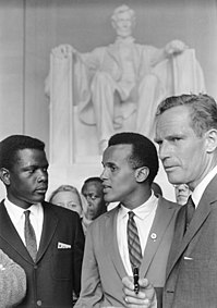 Belafonte (center) at the 1963 Civil Rights March on Washington, D.C with Sidney Poitier (left) and Charlton Heston