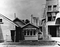 """Lasky's original studio (a.k.a. """"The Barn"""") as it appeared in the mid 1920s. The Taft building, built in 1923, is visible in the background."""