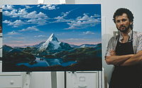 Artist Dario Campanile poses with a picture Paramount commissioned him in 1986 to paint for its 75th anniversary. The company later used the painting as a basis for its new logo. That logo was introduced as a prototype in the 1986 film The Golden Child; the 1987 film Critical Condition was the first to feature the finalized version of the logo. 1999's South Park: Bigger, Longer & Uncut was the first to use an enhanced version of the logo, which was last used on 2002's Crossroads.