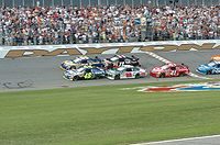 """#48-Jimmie Johnson takes the green flag alongside #55-Michael Waltrip in the start of the 50th running of """"The Great American Race""""."""