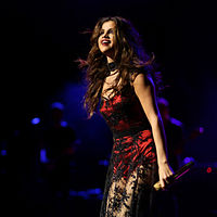 Gomez performing at the 2013 Jingle Ball