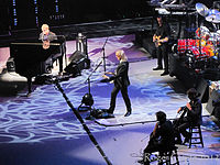 The Elton John Band performing on 15 March 2012. Left to right: John, Johnstone, Birch, and (not pictured, right), Olsson and Cooper