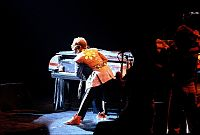 Elton John on the piano during a live performance in 1975