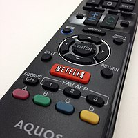 An Aquos remote control with a Netflix button