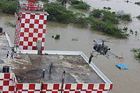 An Indian Air Force helicopter rescues stranded people during 2015 Chennai Floods.