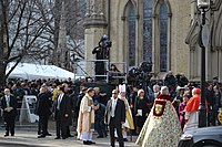 Media overlooking a crowd fronting the Cathedral Church of St. James in Toronto during Flaherty's state funeral on 16 April 2014
