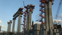 The super-columns are all nearly complete, with one crossbeam already in place, which will support the retractable roof, February 6, 2010
