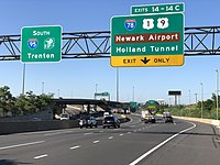 View south along the New Jersey Turnpike/Interstate 95 approaching the exit for Interstate 78, U.S. Route 1 and U.S. Route 9 in Newark